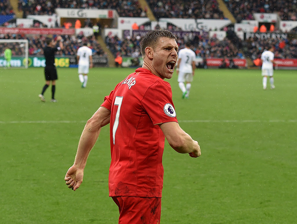 SWANSEA, WALES - OCTOBER 01:  (THE SUN OUT, THE SUN ON SUNDAY OUT) James Milner of Liverpool celebrates after scoring the winning goal during the Premier League match between Swansea City and Liverpool at Liberty Stadium on October 1, 2016 in Swansea, Wales.  (Photo by John Powell/Liverpool FC via Getty Images)