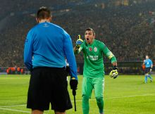 DORTMUND, GERMANY - NOVEMBER 04:  Goalkeeper Fernando Muslera (R) of Galatasaray shouts at the assistant referee during the UEFA Champions League Group D match between Borussia Dortmund and Galatasaray AS at Signal Iduna Park on November 4, 2014 in Dortmund, Germany.  (Photo by Boris Streubel/Getty Images)
