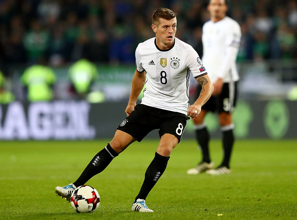 HANOVER, GERMANY - OCTOBER 11: Toni Kroos of Germany runs with the ball during the FIFA 2018 World Cup Qualifier Group C match between Germany and Northern Ireland at HDI-Arena on October 11, 2016 in Hanover, Lower Saxony.  (Photo by Martin Rose/Bongarts/Getty Images)