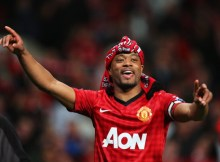 MANCHESTER, ENGLAND - APRIL 22: Patrice Evra of Manchester United celebrates victory and winning the Premier League title after the Barclays Premier League match between Manchester United and Aston Villa at Old Trafford on April 22, 2013 in Manchester, England.  (Photo by Alex Livesey/Getty Images)