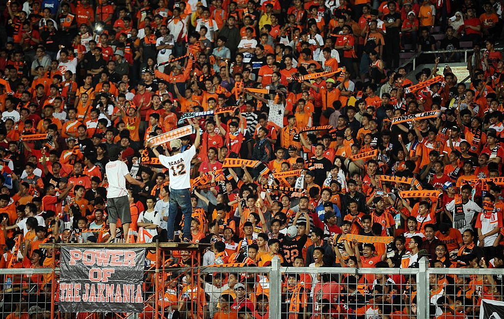 JAKARTA, INDONESIA - MAY 11:  Persija Jakarta supporters during the international friendly match between Perija Jakarta and AFC Ajax on May 11, 2014 in Jakarta, Indonesia. AFC Ajax win the game 3-0.  (Photo by Robertus Pudyanto/Getty Images)