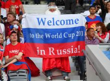 TOULOUSE, FRANCE - JUNE 20: A Russia fan with his 2018 World Cup flag before the UEFA EURO 2016 Group B match between Russia and Wales at Stadium Municipal on June 20, 2016 in Toulouse, France.  (Photo by Stu Forster/Getty Images)