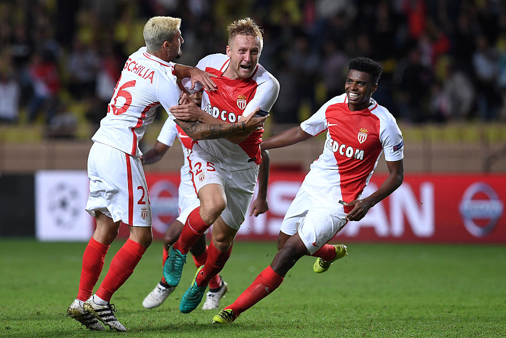 MONACO - SEPTEMBER 27: Kamil Glik (C) of AS Monaco FC celebrates after scoring the equalizer goal with team mates during the UEFA Champions League Group E match between AS Monaco FC and Bayer 04 Leverkusen at Louis II Stadium on September 27, 2016 in Monte Carlo, Monaco. (Photo by Valerio Pennicino/Getty Images)