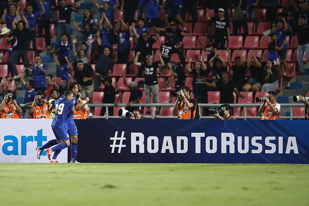 BANGKOK, THAILAND - NOVEMBER 15:  Teerasil Dengda of Thailand celebrates with his team after scoring Australia's first goal during the 2018 FIFA World Cup Qualifier match between Thailand and the Australia Socceroos at Rajamangala National Stadium on November 15, 2016 in Bangkok, Thailand.  (Photo by Mark Kolbe/Getty Images)