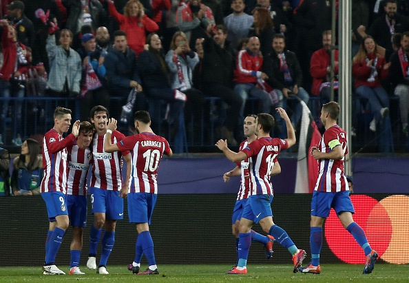 MADRID, SPAIN - NOVEMBER 1: Antoine Griezmann (2nd L) of Atletico Madrid celebrates his goal with his teammates during the UEFA Champions League football match between Atletico Madrid and FC Rostov at Vincente Calderon Stadium in Madrid, Spain on November 1, 2016. (Photo by Burak Akbulut/Anadolu Agency/Getty Images)
