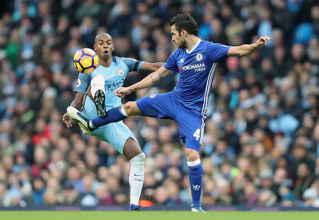 MANCHESTER, ENGLAND - DECEMBER 03: Fernandinho of Manchester City and Cesc Fabregas of Chelsea during the Premier League match between Manchester City and Chelsea at Etihad Stadium on December 3, 2016 in Manchester, England. (Photo by James Baylis - AMA/Getty Images)