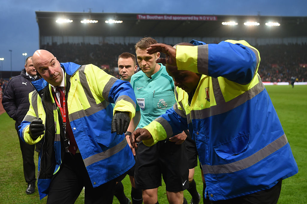 STOKE ON TRENT, ENGLAND - DECEMBER 17: Referee Craig Pawson is escorted off at half time by stewards during the Premier League match between Stoke City and Leicester City at Bet365 Stadium on December 17, 2016 in Stoke on Trent, England.  (Photo by Michael Regan/Getty Images)