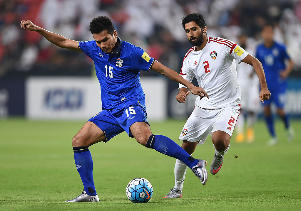 ABU DHABI, UNITED ARAB EMIRATES - OCTOBER 06: Salem Salem Al Rejaibi of UAE and Koravit Namwiset of Thailand in action during the 2018 FIFA World Cup Qualifier match between UAE and Thailand at Mohamed Bin Zayed Stadium on October 6, 2016 in Abu Dhabi, United Arab Emirates. (Photo by Tom Dulat/Getty Images)