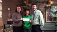 Ellis Elementary School Student Body President Jaxsen Tuia and advisor Aaron Hall present check to The Idaho Foodbank's Rebecca Ristrem