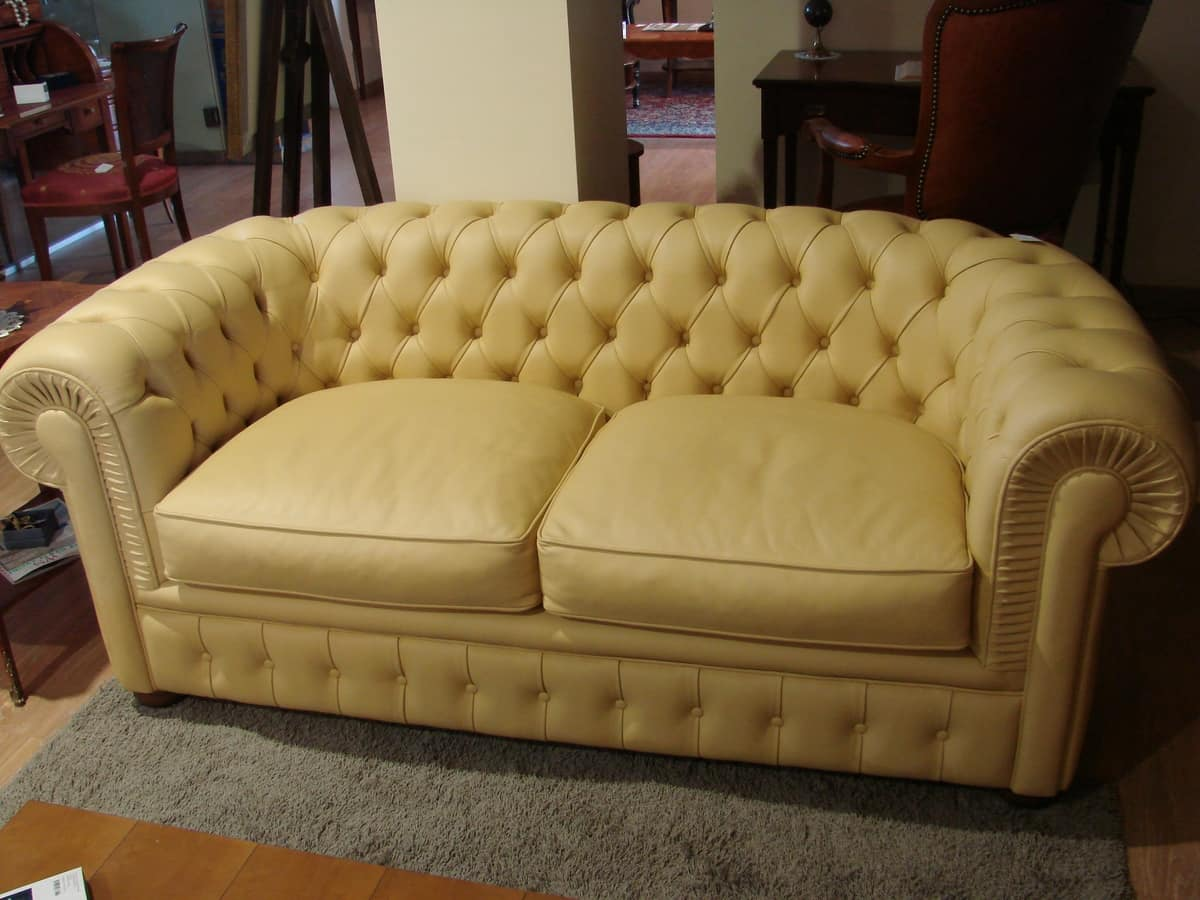 Cream Colored Leather Sofa With Capitonné Padding Idfdesign