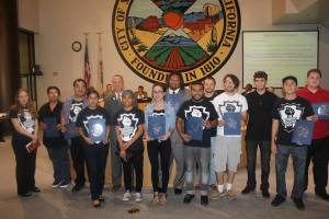"Photo/Anthony Victoria  San Bernardino Generation Now members hold their ""Citizen of the Month"" certificates up to attendees at the San Bernardino City Council meeting on May 19."