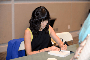 "Courtesy Photo  Following her keynote speech at the Women's Conference on January 16, Laura Ling interacted with guests and signed copies of her memoir, ""Somewhere Inside: One Sister's Captivity in North Korea and the Other's Fight to Bring Her Home,"" which she penned with her sister, Lisa."