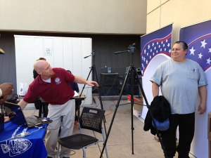 iecn photo/yazmin alvarez  A local veteran gets his photo taken for his new Military Veteran ID card offered through the County of San Bernardino. The card can be used to receive half off fares through Omnitrans along with other benefits with area businesses.