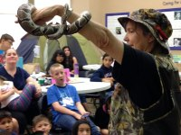 iecn photo/yazmin alvarez&lt;br /&gt;&lt;br /&gt;<br /> Cheryl Rendes of Wonders of Wildlife Inc., holds up Spaulding, a ball python during Critter Camp.