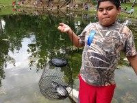 iecn photo/yazmin alvarez<br /><br /><br /><br /><br /><br /><br /><br /> Salvador Romero shows off his 2 1/2 lb. catch during the fishing derby.