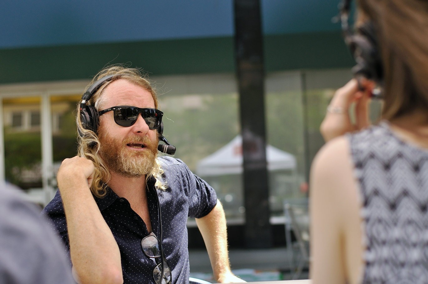 Kristin Archer interviewing Matt Berninger of The National and their manager Brandon Reid. Photo by Lisa Vuyk
