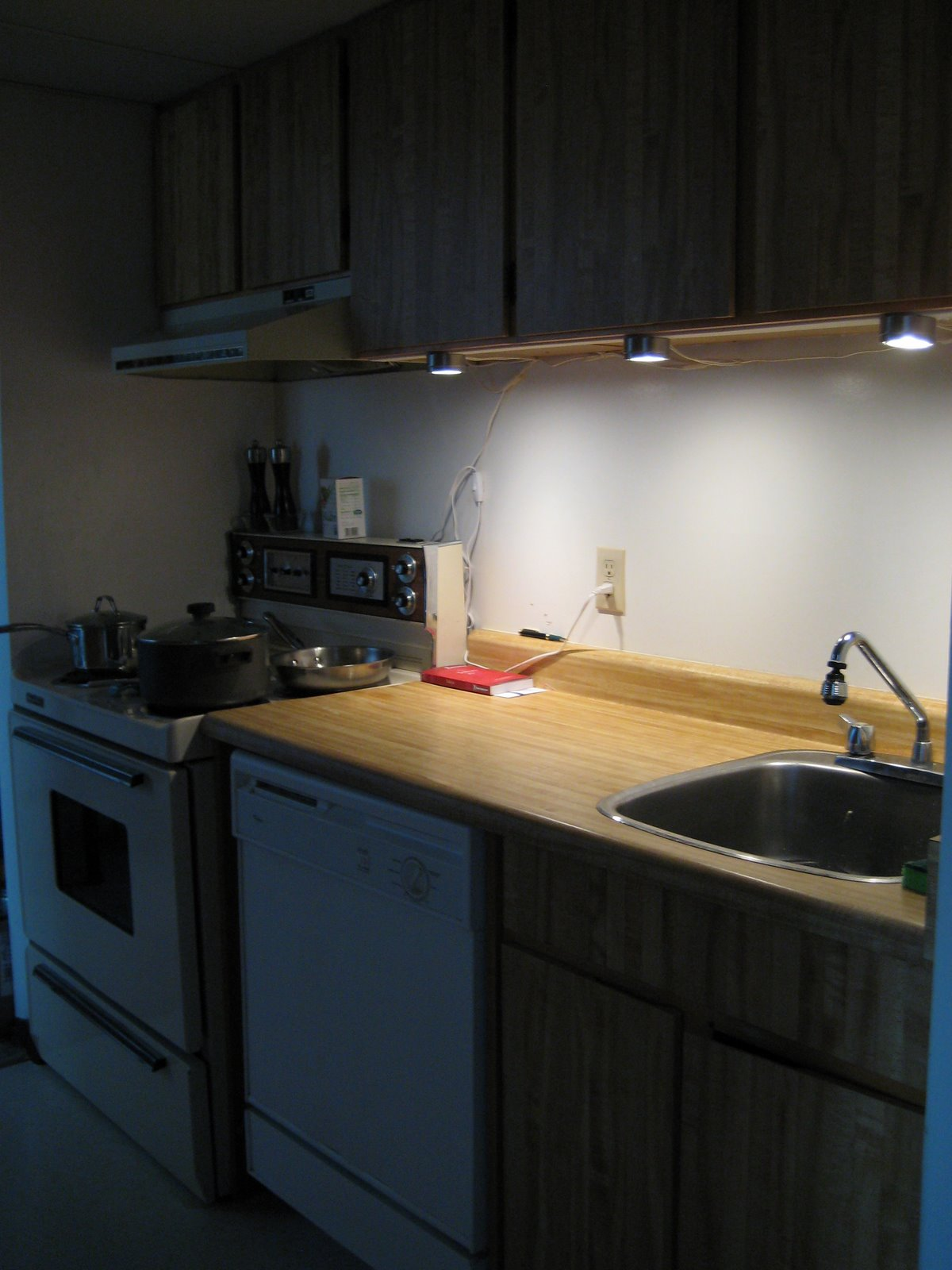improve your kitchen counter lighting ikea kitchen lighting I then attached the halogen portion of the lights clipped the wires and switches up and out of the way and now have some nice task lighting