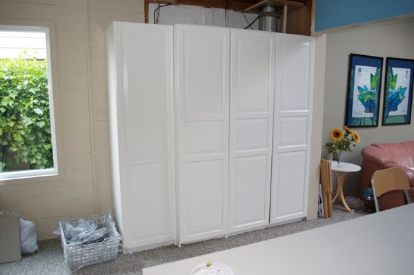 Cabinet to hide the boiler and fuse box - IKEA Hackers