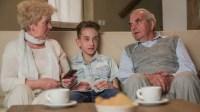 Grandparents And Grandchildren In Living Room Watching ...