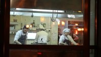 Minsk -January,7,2015 Chefs Preparing Food In The Kitchen ...
