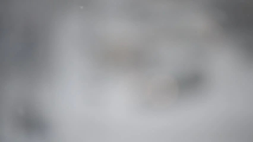 Moving Falling Snow Wallpaper Close Up Of Snow Falling On Blurry Grey And White