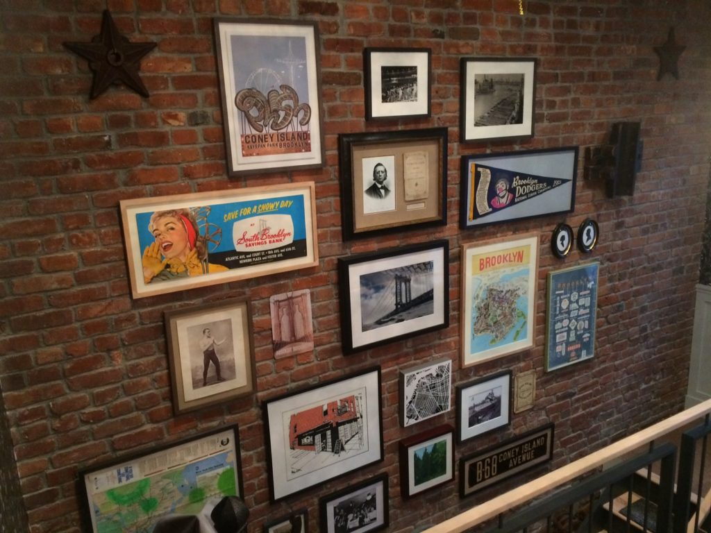 Wall Art For Brick Walls Guide To Art Placement Picture Hanging And Installation