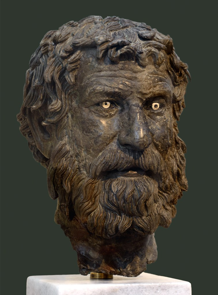 "The ""Philosopher of Anthykera"", a 3rd Century BCE bronze head discovered near the Anthykera shipwreck."
