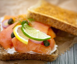 """A delicious smoked salmon canape with cream cheese, onion, lemon and dill."""