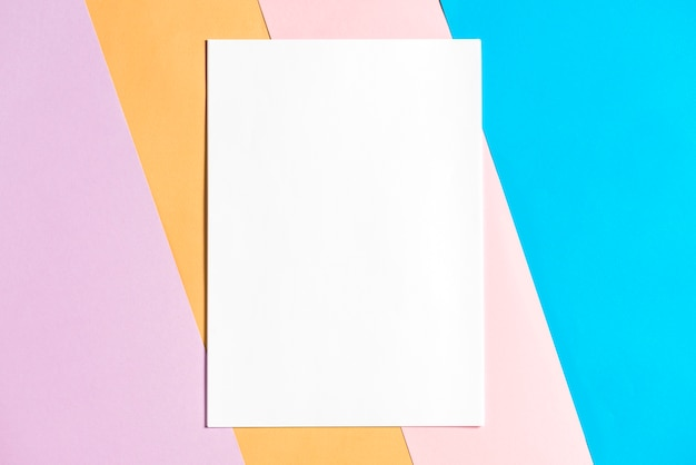 Blank paper on colorful papers background Photo Free Download