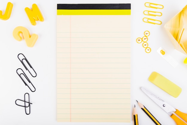 Blank sheet of paper with school supplies Photo Free Download