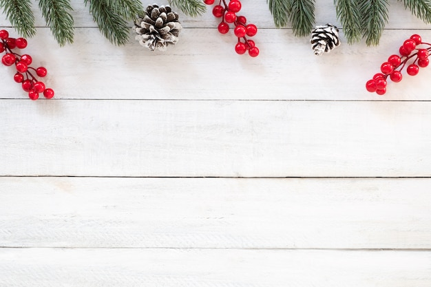 Christmas and New year background with fir branches, holly berry and - christmas background image
