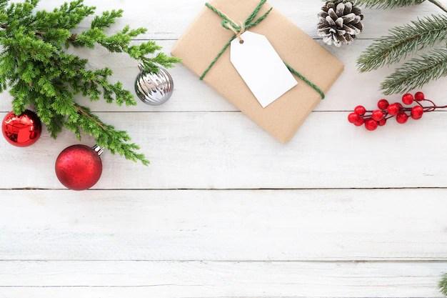 Christmas theme Background Christmas present gift box, fir branches - christmas theme background