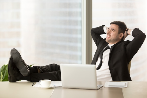 Company director relaxing at workplace in office Photo Free Download