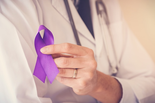 Doctor hands holding purple ribbon, alzheimer disease, epilepsy