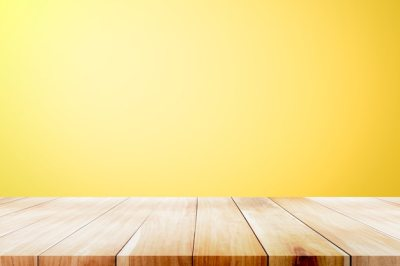 Empty wooden deck table over yellow wallpaper background. Photo | Premium Download