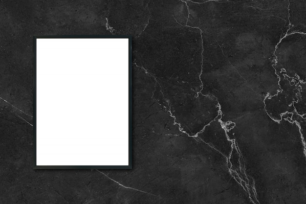 Mock up blank poster picture frame hanging on black marble wall in