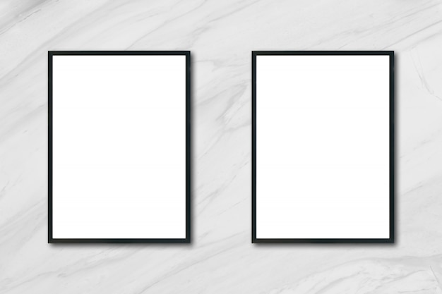Mock up blank poster picture frame hanging on white marble wall in