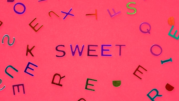 Sweet spelled word with alphabets background Photo Free Download - word alphabets