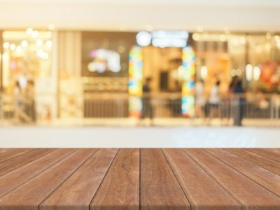 Wooden board empty table blurred background. Perspective brown wood over blur in department ...