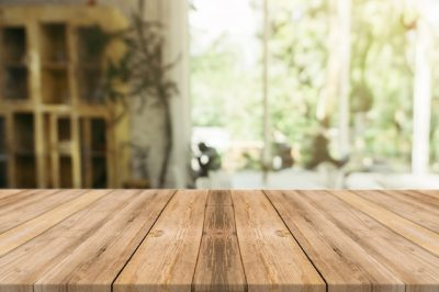 Wooden board empty table in front of blurred background. Perspective brown wood over blur in ...