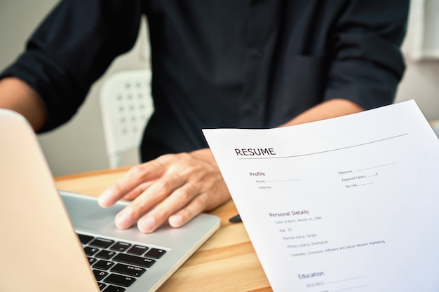 Young woman submit resume to employer to review job application the