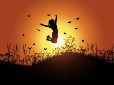 Backlit girl with sunset background Vector | Free Download