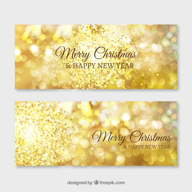 Golden shiny banners for merry christmas and new year Vector Free