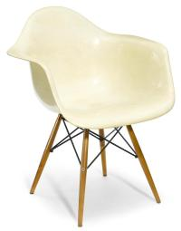 A Charles and Ray Eames fiberglass and walnut Dowel Leg Chai