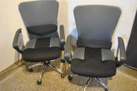 Pair of adjustable mid-century style office chairs on caster