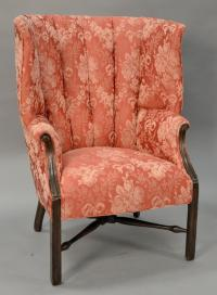 Mahogany upholstered barrel back chair.