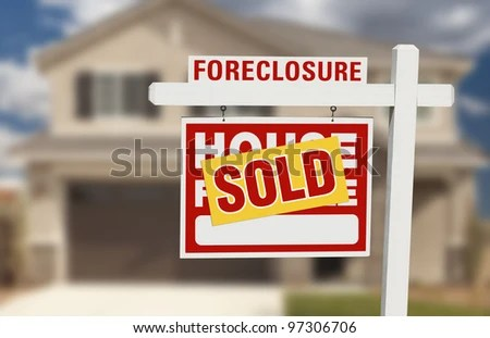 Sold Foreclosure Home For Sale Sign and House with Dramatic Sky