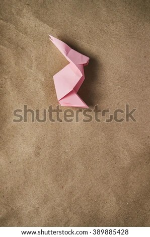 Free photos Pink bunny on eco craft paper background Easter
