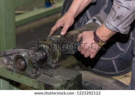 Free photos Industrial mechanic repairing heavy industry machine in