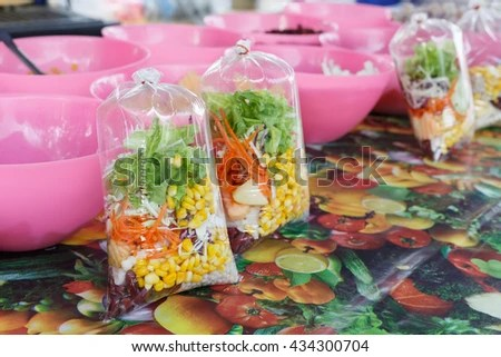 Free photos Salad bar, fresh vegetable salad in a plastic bag